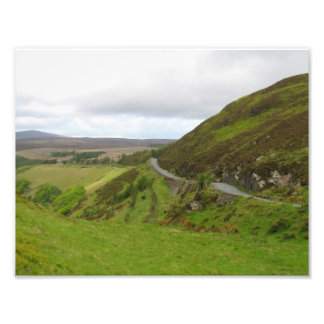 Countryside road bends around hill in Ireland Photo