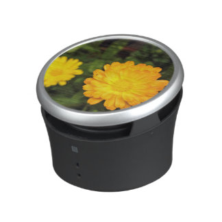 Couple of small yellow flowers bluetooth speaker