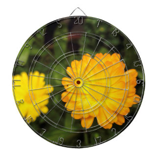 Couple of small yellow flowers dartboard with darts