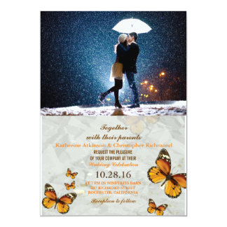 Couple with umbrella kissing at snow/butterfly card
