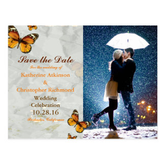 Couple with umbrella kissing at snow/butterfly postcard