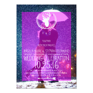 Couple with umbrella kissing at snow/deer theme card