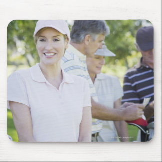 Couples preparing to play golf mouse pad