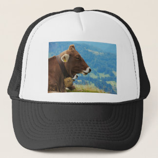 Cow in the mountains trucker hat