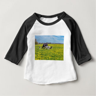Cow with calves grazing in meadow with dandelions baby T-Shirt