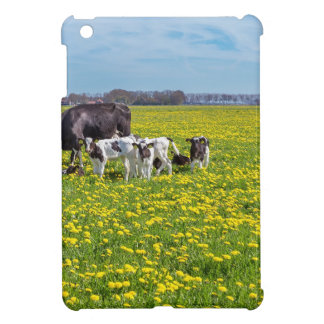Cow with calves grazing in meadow with dandelions iPad mini cover