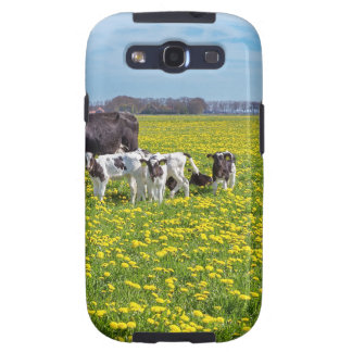 Cow with calves grazing in meadow with dandelions samsung galaxy SIII covers