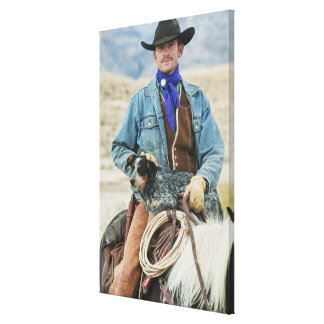 Cowboy and dog on horse canvas print
