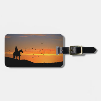 Cowboy and horse in the sunset luggage tag
