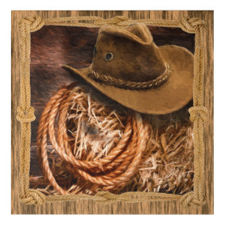 Cowboy hat and lariat on straw bale acrylic print
