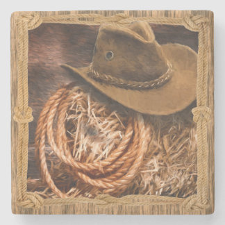 Cowboy hat and lariat on straw bale stone coaster