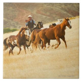 Cowboy herding horses 3 tile