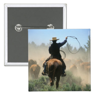 Cowboy on horse with lasso driving cattle pinback button