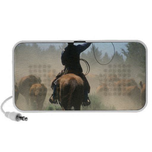 Cowboy on horse with lasso driving cattle iPhone speakers