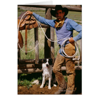 Cowboy posing with lasso and pet dog card