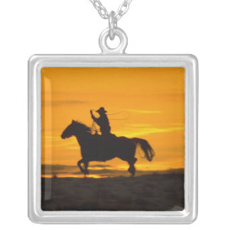 Cowboy riding in the Sunset with lariat Rope 2 Silver Plated Necklace