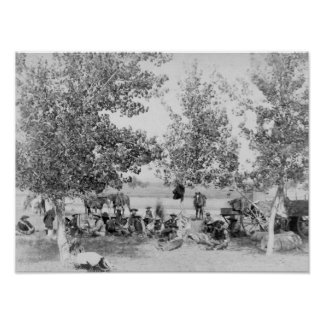 Cowboys Eating Dinner on Ground Under Trees Poster