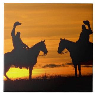 Cowboys on ridge at Sunset Tile