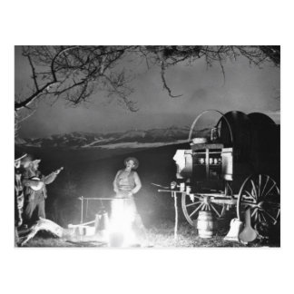 Cowboys playing and singing around a campfire postcard