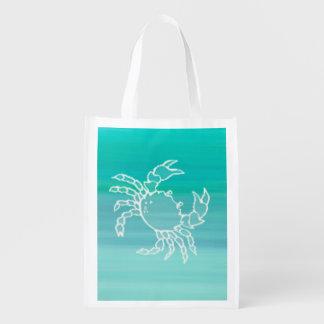 Crab in aquamarine colored ocean reusable grocery bag