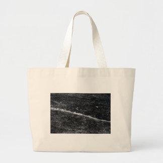 Crack in black ice. large tote bag