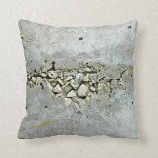Cracked concrete wall with small stones throw pillow
