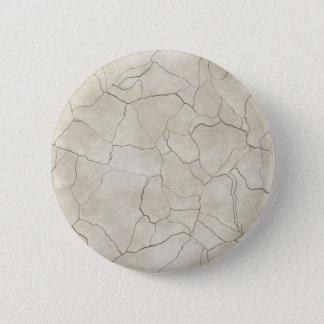 Cracks on Beige Textured Background 2 Inch Round Button