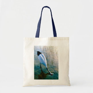 Crane feeding in shallow water tote bag