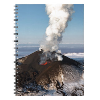 Crater eruption volcano: lava, gas, steam, ashes spiral note books