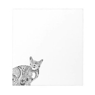 Crazy cat eyes looking up notepad