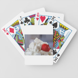 Cream with strawberries in a glass bowl poker deck
