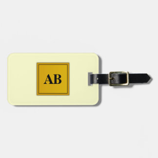Cream yellow solid color with monogram luggage tag