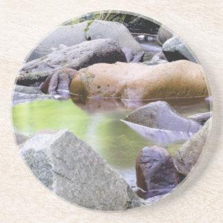creek among stones coaster