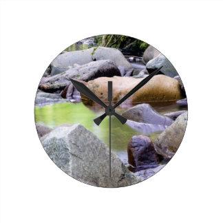 creek among stones round clock