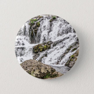 creeks pours over rocks 2 inch round button