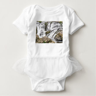 creeks pours over rocks baby bodysuit