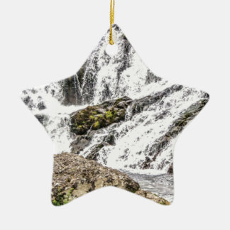 creeks pours over rocks ceramic ornament
