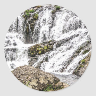 creeks pours over rocks classic round sticker