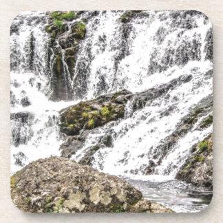 creeks pours over rocks coaster