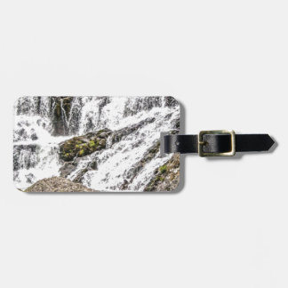 creeks pours over rocks luggage tag