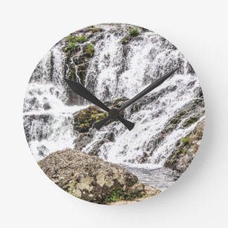 creeks pours over rocks round clock