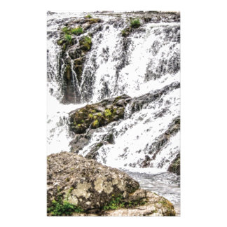 creeks pours over rocks stationery