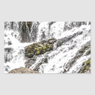 creeks pours over rocks sticker