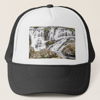 creeks pours over rocks trucker hat