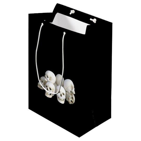 Creepy pile of skulls black medium gift bag