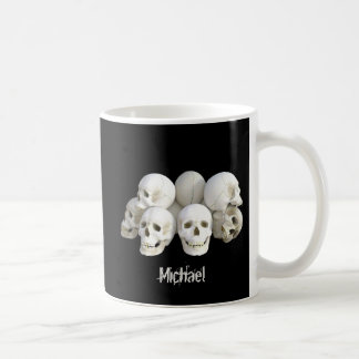 Creepy skulls pile coffee mug