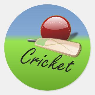 Cricket - bat and ball on grassy horizon classic round sticker