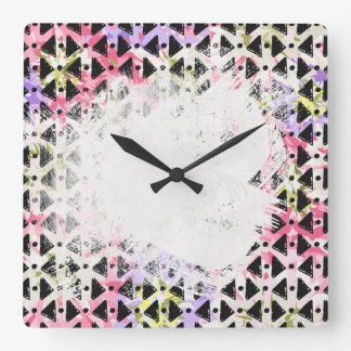 Criss cross diamond shaped colourful patterned wall clocks