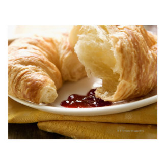 Croissant with jam on a plate postcard