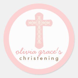Croix religieuse rose douce de célébration sticker rond